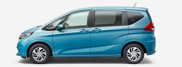 Gambar mobil Honda Freed 2017 berwarna biru dilihat dari bagian samping