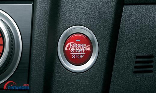 Gambar menunjukkan fitur One Push Engine Button di mobil Honda Jazz 2016