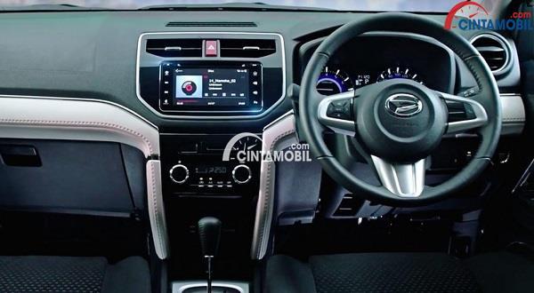 Bagian dashboard dan interior Daihatsu Teios 2018 dengan akses berwarna hitam