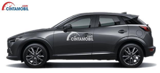 Gambar mobil Mazda CX-3 2017 berwarna abu-abu hitam dilihat dari sisi samping