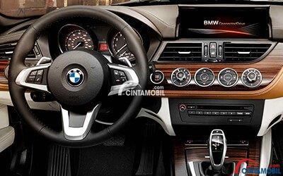 Gambar bagian dashboard mobil BMW Z4 2017 dengan berbagai fitur di atas