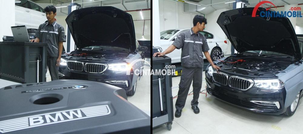 Seorang mekanik BMW sedang melakukan pemeriksaan berbasis komputer
