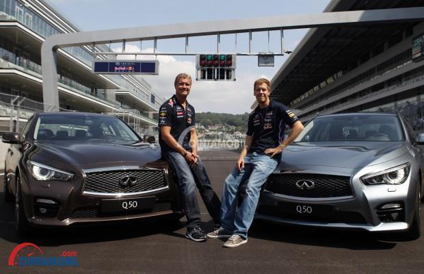 Tampilan Infiniti Q50 2014 bersama sang perancang, Sebastian Vettel (kanan), sang jawara F-1
