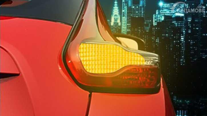 Gambar yang menunjukan lampu sein mobil yang berwarna kuning