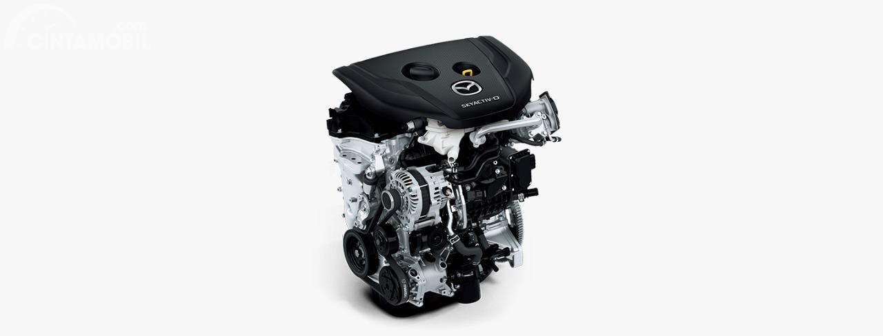 Gambar menunjukkan mesin diesel Skyactiv-D pada mobil Mazda 2 2019