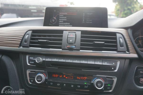 Gambar menunjukkan Kontrol AC BMW 320d 2014