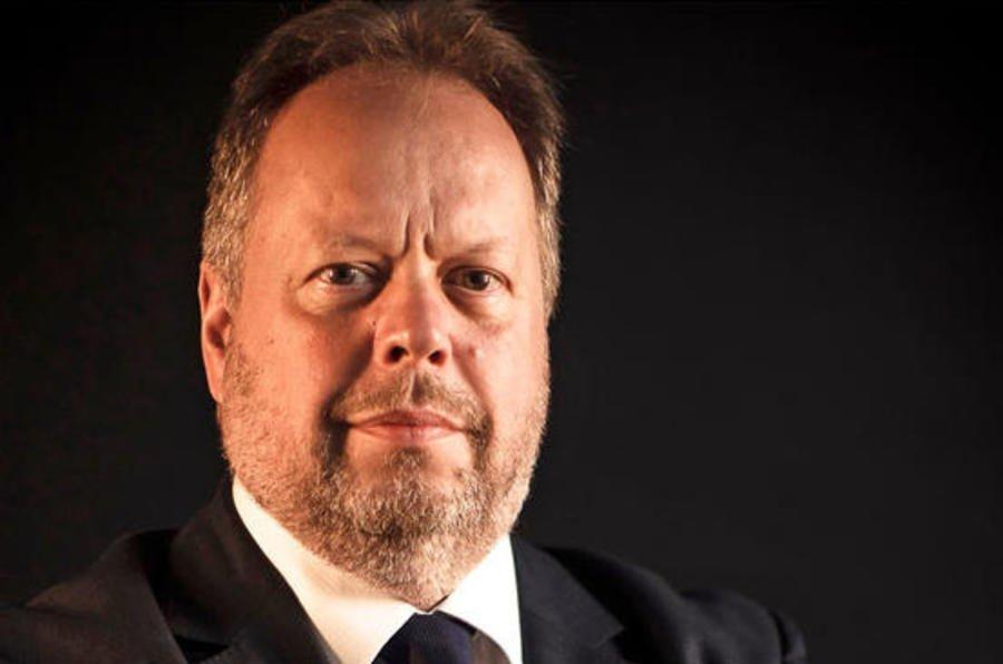 Gambar menunjukan Andy Palmer