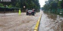 Ini Cara Aman dan Mudah Melewati Jalan Tergenang Banjir