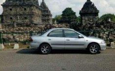 Mazda Familia  1997 Abu-abu