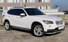 Mobil BMW X1 XLine Executive AT 2015 terbaik di Jawa Timur
