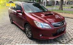 Jual Cepat Mobil Subaru Exiga 2010 Merah di Jawa Timur