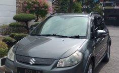 Jual Cepat Mobil Suzuki SX4 X-Over 2009 Abu-abu di Jawa Timur