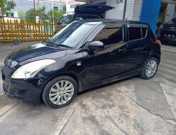 Mobil Suzuki Swift 2013 GL terbaik di Jawa Timur