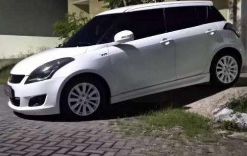 Mobil Suzuki Swift 2014 GX terbaik di Jawa Timur