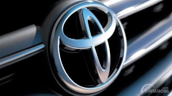 Gambar yang menunjukan logo perusahaan Toyota