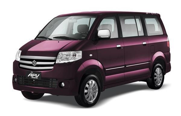 mobil Suzuki APV mempunyai bentuk mengotak berwarna ungu