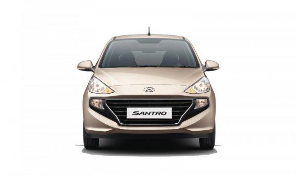 Gambar mobil Hyundai Santro 2019 berwarna coklat dilihat dari sisi depan
