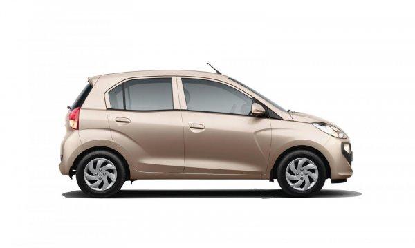 Gambar mobil Hyundai Santro 2019 berwarna coklat dilihat dari sisi samping