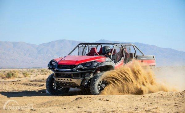 Gambar yang menunjukan pengendaraan Honda Rugged Open Air Vehicle