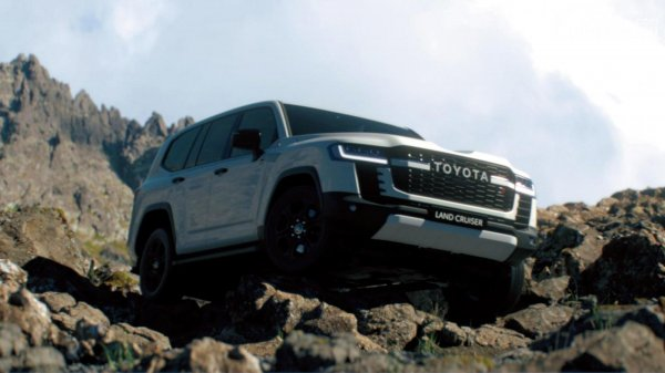 Toyota Land Cruiser 300 yang ada di atas batu